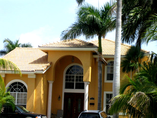 Painting Contractor & Waterproofing Miami Mustard Colored Home